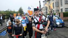 """A man plays the bagpipes on a """"short walk to freedom"""" march in Edinburgh, Scotland September 18, 2014."""