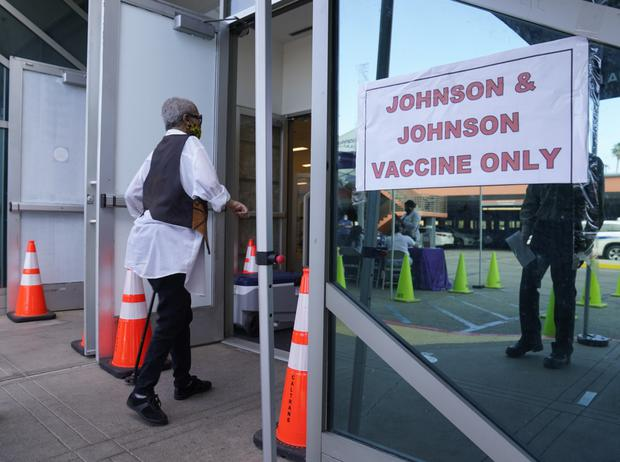 People walk in to get their Covid-19 vaccine at the Baldwin Hills Crenshaw Plaza in Los Angeles earlier in April (Damian Dovarganes/AP)
