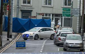 Forensic officers at the scene on Main Street in Castlerea, Co Roscommon this morning. Photo: Mark Condren
