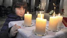 Rachel Casey from Dublin admiring 5 candles which were brought up before mass to symbolise hope and life at the special mass for for solidarity with the people of France at the Pro-Cathedral in Dublin yesterday. Picture: John Mc Elroy