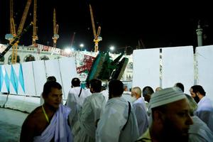 A towering construction crane, center, is seen collapsed over the Grand Mosque, in Mecca, Saudi Arabia, early Saturday morning, Sept. 12, 2015. The construction crane toppled over on Friday during a violent rainstorm in the Saudi city of Mecca, Islam's holiest site, crashing into the Grand Mosque, ahead of the start of the annual hajj pilgrimage later this month. (AP Photo)