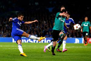 Chelsea's Eden Hazard hits a shot as Christian Fuchs of Schalke closes in during the Champions League game at Stamford Bridge. Photo: Clive Rose/Getty Images