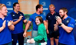After their recent success at the Special Olympics World Games in Los Angeles, where Team Ireland brought home 86 medals, Leinster invited some of the athletes that competed at the games into Leinster headquarters at UCD in Dublin to celebrate their achievements and for a behind the scenes tour. Pictured are Megan Reynolds, from Blackrock, Co Dublin, with Leinster players (from left) Mike McCarthy, Dominic Ryan, head coach Leo Cullen and Isaac Boss. Photo: Matt Browne