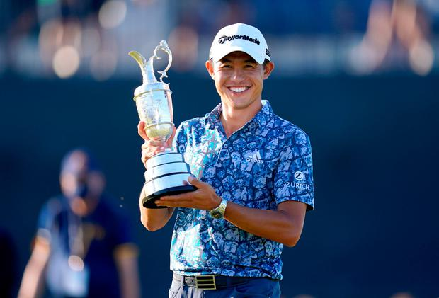 USA's Collin Morikawa celebrates with the Claret Jug after winning the 149th Open Championship at The Royal St George's Golf Club in Sandwich, Kent.