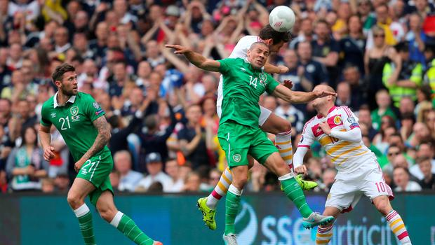 Scotland's Russell Martin and Ireland's John Walters battle for the ballduring the UEFA European Championship Qualifying match at the Aviva Stadium, Dublin.  Niall Carson/PA Wire