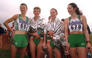 Sonia O'Sullivan, Anne Keenan-Buckley, Rosemary Ryan and Maureen Harrington at the end of the Senior Women's Short Race at the World Cross Country Championships in Leopardstown in March 2002. Photo: David Maher/Sportsfile