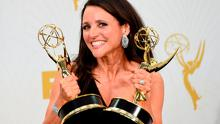 Actress Julia Louis-Dreyfus, poses in the Press Room with her award for Lead Actress in a Comdey Series during the 67th Emmy Awards
