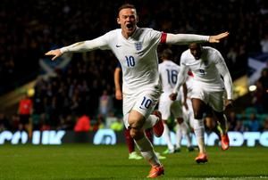 Wayne Rooney celebrates after scoring England's second goal in their friendly against Scotland at Celtic Park. Photo: Alex Livesey/Getty Images