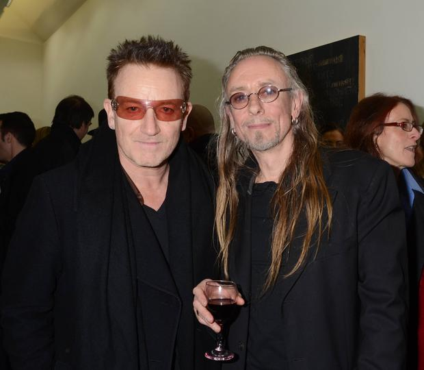 Guests arrive at the artist Guggi's latest exhibition in the Kerlin Gallery, South Anne Street, Dublin, Ireland - 24.01.13. Pictures: VIPIRELAND.COM *** Local Caption *** Bono, Guggi