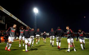 Manchester United players warm up before their English FA Cup 4th round soccer match against Cambridge United