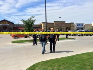Police escort a man at the scene of a shooting in Waco, Texas, in this handout photo provided by the Waco Police Department on May 17, 2015.  REUTERS/Waco Police Department/Handout