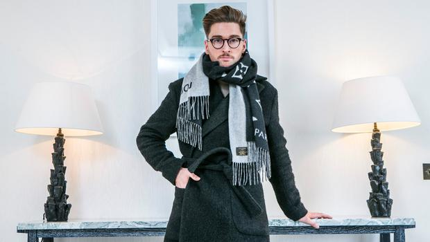 Rob Kenny wears: Trousers, COS; coat H&M Studio Collection; scarsf, Louis Vuitton; shoes, Kurt Geiger; glasses, Specsavers. Picture: Kyran O'Brien