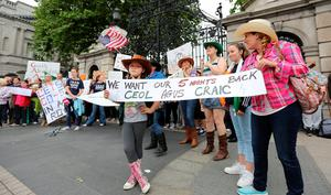 Garth Brooks fan Cara Cronly (8) at the protest outside Dail Eireann.  Picture;  GERRY MOONEY.  13/7/14