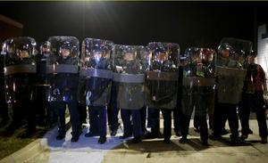 Missouri State Troopers in riot gear stand in formation outside the Ferguson Police Department in Ferguson, Missouri, November 24, 2014. A St. Louis County grand jury chose not to indict Ferguson policeman Darren Wilson in the Aug. 9 shooting death of Michael Brown, 18, St. Louis County Prosecutor Bob McCulloch said.  REUTERS/Adrees Latif