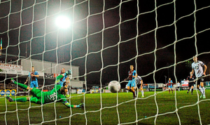 Richie Towell, Dundalk, beats Drogheda United goalkeeper Michael Schlingermann to score his side's sixth goal
