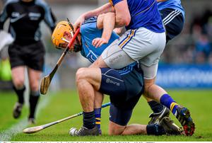 Dublin's Paul Schutte tries to win possession of the sliothar under pressure from Tipperary's Denis Maher