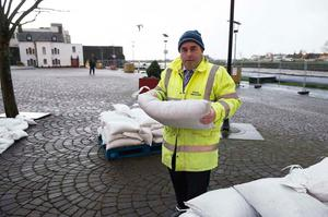Kevin 'Boxer' Moran with sandbags in Galway, one of the worst counties affected by Storm Eleanor. Photo: Andrew Downes