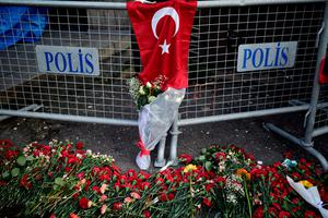 Flowers and a Turkish flag are placed near the entrance of Reina nightclub, which was attacked by a gunman, in Istanbul, Turkey January 2, 2017. REUTERS/Yagiz Karahan