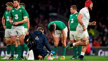 James Haskell, England, leaves the pitch after being shown a yellow card, as Conor Murray, Ireland, recieves attention. Picture credit: Brendan Moran / SPORTSFILE