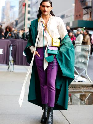 =Model Rahi Chadda is seen wearing a teal coat, white shirt, purple pants, several handbags and black boots all by Coach outside of the Coach 1941 show during New York Fashion Week on February 11, 2020 in New York City. (Photo by Donell Woodson/Getty Images)