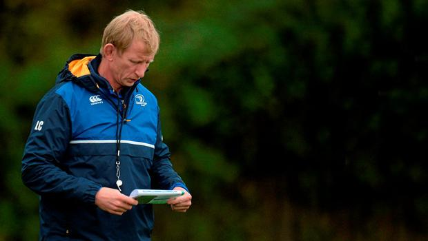 Leinster's coach, Leo Cullen, consults his notes before training.
