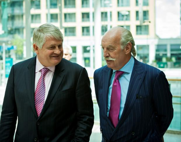 Denis O'Brien, Chairman National College of Ireland (NCI) and guest speaker Dermot Desmond, are pictured at a business lunch in the college Photo: John T Ohle