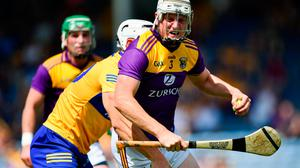 17 July 2021; Liam Ryan of Wexford in action against Aron Shanagher of Clare during the GAA Hurling All-Ireland Senior Championship Round 1 match between Clare and Wexford at Semple Stadium in Thurles, Tipperary. Photo by Piaras Ó Mídheach/Sportsfile