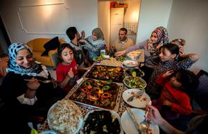 Ihab, 30, a Syrian migrant and his family (L) from the Syrian city of Deir al-Zor, attend a welcoming dinner by his parents at their house upon their arrival in Lubeck, Germany, in this September 18, 2015 file picture. REUTERS/Zohra Bensemra/Files
