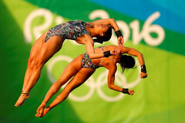 Ingrid Oliveira and Giovanna Pedroso of Brazil compete in the Women's Diving Synchronised 10m Platform Final on Day 4 of the Rio 2016 Olympic Games at Maria Lenk Aquatics Centre on August 9, 2016 in Rio de Janeiro, Brazil. (Photo by Clive Rose/Getty Images)