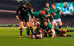 Jacob Stockdale celebrates after scoring Ireland's first try during the Guinness Series International match between Ireland and New Zealand at the Aviva Stadium, Dublin. Photo: Ramsey Cardy/Sportsfile