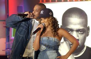 "Jay-Z and Beyonce Knowles during ""Spankin' New Music Week"" with Jay-Z, Beyonce Knowles and Solange Knowles on MTV's ""TRL"" in November  2002"