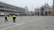 Empty: Police officers patrol a virtually deserted St Mark's Square in Venice after a decree for the whole of Italy to be put on lockdown. Photo: REUTERS/Manuel Silvestri