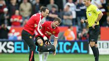 Jonny Evans is helped off the field during Manchester United's Premier League defeat to Leicester City. Photo: Plumb Images/Leicester City FC via Getty Images