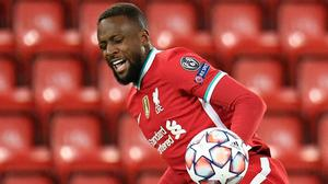 Liverpool's Divock Origi grimaces as he loses the ball in the defeat by Atalanta in the Champions League at Anfield