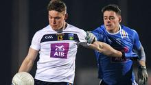 Hectic schedule: Con O'Callaghan in action for UCD against DIT's Brian Howard during last night's Sigerson Cup match at Billings Park. Photo by Eóin Noonan/Sportsfile