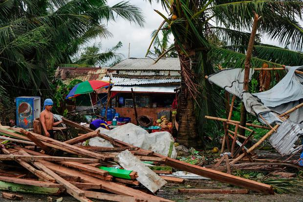 A resident looks at a house damaged at the height of Typhoon Phanfone in Tacloban, Leyte province in the central Philippines on December 25, 2019. (Photo by BOBBIE ALOTA/AFP via Getty Images)