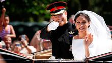 Britain's Prince Harry and his wife Meghan wave as they ride a horse-drawn carriage after their wedding ceremony at St George's Chapel in Windsor Castle in Windsor, Britain, May 19, 2018. REUTERS/Damir Sagolj