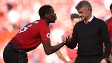 Paul Pogba shakes hands with Manchester United manager Ole Gunnar Solskjaer. Photo: Oli SCARFF / AFP
