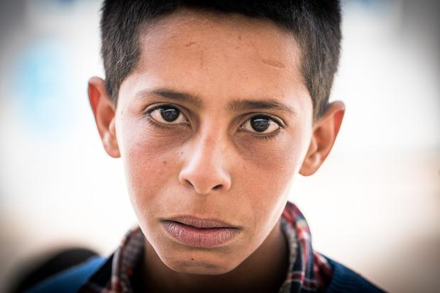 Ali Salim Mousa Ka'abneeh (14) from the West Bank. Two years ago the Israeli army attempted to knock down his family home. Since the event he has developed a severe speech impediment and has barely spoken since.