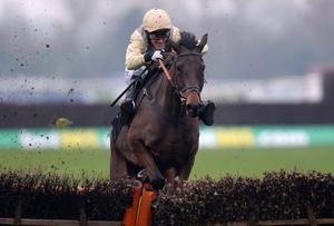 Our Sam ridden by jockey Barry Geraghty jumps the last on the way to victory in the Inkerman London Novices' Hurdle at Newbury yesterday. Andrew Matthews/PA Wire