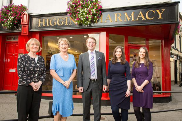 L to R: The three Higgins siblings, Ann Christine, Stella and Ken, (l to r) hand the keys to the business, which includes two pharmacies in Sligo town, over to new owners, twins Ann and Deirdre Butler