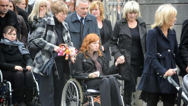 Attending the funeral of Brendan Donnolly which took place at St. Brendan' s Church, Birr, Co Offaly October 29, 2009, were, seated in wheelchairs Kate Flynn and Brendan' s girlfriend Laura Connelly ( C) holding hands with Brendan' s mother Christine.