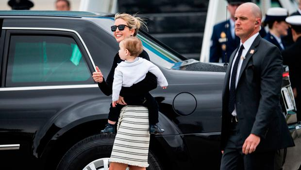 Ivanka Trump, centre, heads to a vehicle after arriving on Air Force One with her father President Donald Trump at the Palm Beach International Airport in West Palm Beach, Fla., on Friday, March 3, 2017.