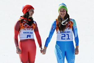 Dominique Gisin of Switzerland and Tina Maze of Slovenia win joint gold medals during the Alpine Skiing Women's Downhill