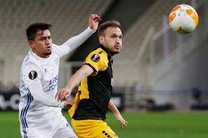 Leicester City's Cengiz Under in action with AEK Athens' Michalis Bakakis. Photo: Reuters