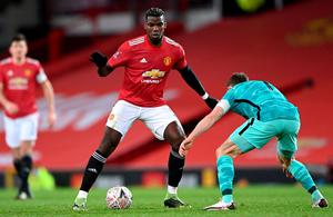 Stand-off: Paul Pogba of Manchester United looks to break past Liverpool's James Milner during their FA Cup tie at Old Trafford. Photo: Getty Images