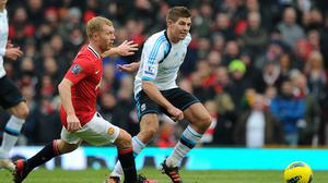 Paul Scholes of Manchester United and Steven Gerrard of Liverpool (Photo by AMA/Corbis via Getty Images)