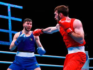Ireland's Afanasev Kirill (blue) defeats Georgia's Begadze Nikoloz (red) during day two of the Boxing Road to Tokyo 2020 Olympic qualifying event at the Copper Box Arena, London.