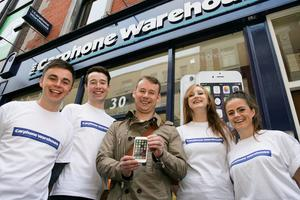 Kevin Whelan with his iPhone 6 after buying it in the Carphone Warehouse