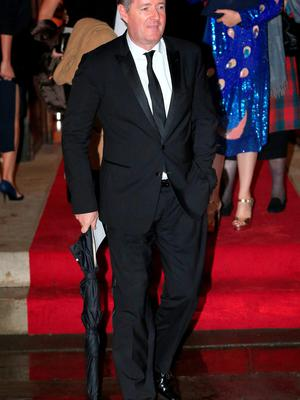 Piers Morgan leaves after the wedding of Christine Bleakley and Frank Lampard at St Paul's Church in Knightsbridge, London
